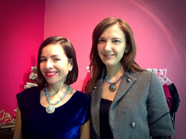 Susana and I wearing statement necklaces