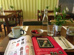 breakfast in a new cafe surrounded by fashion magazines